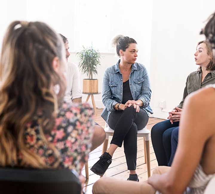 A group of females in a group therapy session